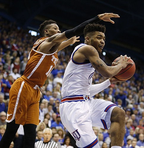 Kansas guard Frank Mason III (0) gets under Texas guard Kerwin Roach Jr. (12) to throw a pass during the second half, Saturday, Jan. 21, 2017 at Allen Fieldhouse.