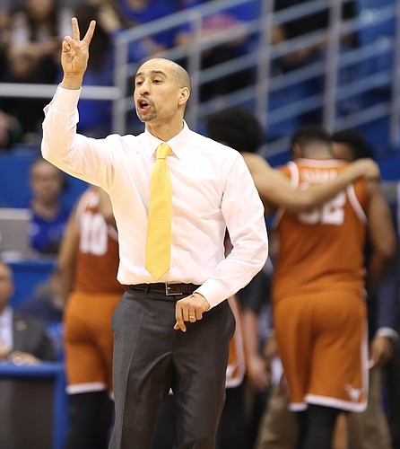 Texas head coach Shaka Smart calls a play during the second half, Saturday, Jan. 21, 2017 at Allen Fieldhouse.