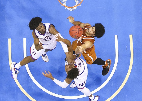 Kansas guard Josh Jackson (11) and Kansas guard Devonte' Graham battle for a rebound with Texas forward Jarrett Allen (31) during the second half, Saturday, Jan. 21, 2017 at Allen Fieldhouse.