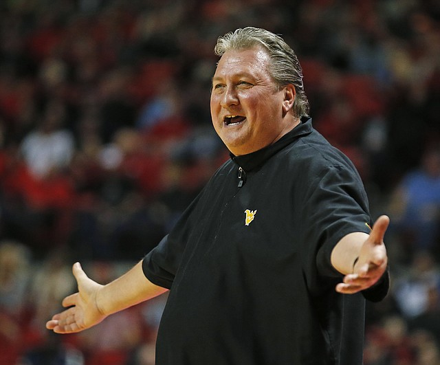 Photo West Virginia Coach Bob Huggins Yells Out After A