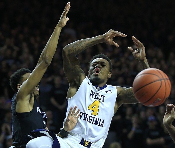 West Virginia guard Daxter Miles Jr. (4) is stripped of the ball by Kansas State guard Kamau Stokes, left, during the first half of an NCAA college basketball game in Manhattan, Kan., Saturday, Jan. 21, 2017.