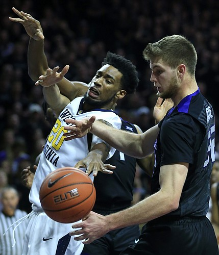 West Virginia forward Brandon Watkins (20) rebounds against Kansas State forward Dean Wade (32) during the first half of an NCAA college basketball game in Manhattan, Kan., Saturday, Jan. 21, 2017.
