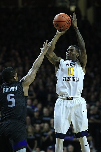 West Virginia guard Teyvon Myers (0) during the first half of an NCAA college basketball game against Kansas State in Manhattan, Kan., Saturday, Jan. 21, 2017.