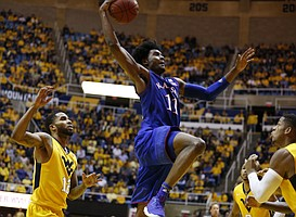 Kansas guard Josh Jackson (11) elevates for a dunk against West Virginia during the second half, Tuesday, Jan. 24, 2017 at WVU Coliseum.