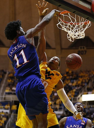 Kansas guard Josh Jackson (11) delivers a dunk over West Virginia forward Sagaba Konate (50) during the second half, Tuesday, Jan. 24, 2017 at WVU Coliseum.