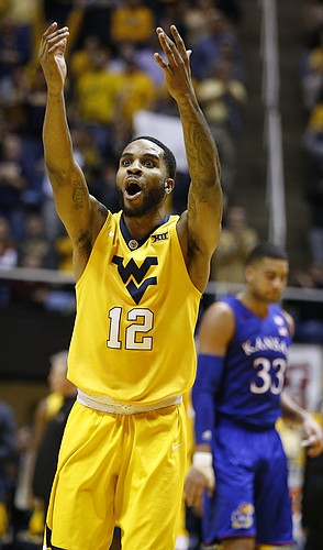 West Virginia guard Tarik Phillip (12) celebrates a dunk by West Virginia forward Sagaba Konate (50) during the second half, Tuesday, Jan. 24, 2017 at WVU Coliseum.