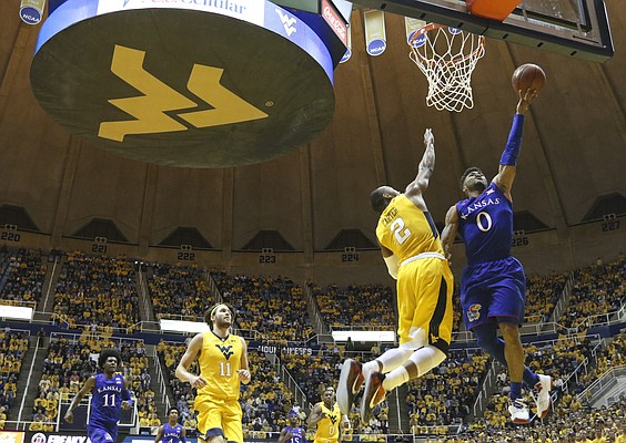 Kansas guard Frank Mason III (0) gets to the bucket against West Virginia guard Jevon Carter (2) during the first half, Tuesday, Jan. 24, 2017 at WVU Coliseum.