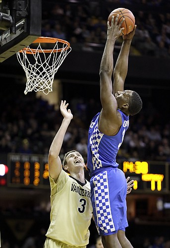 "Kentucky forward Edrice ""Bam"" Adebayo, right, dunks the ball over Vanderbilt forward Luke Kornet during the first half of an NCAA college basketball game Tuesday, Jan. 10, 2017, in Nashville, Tenn."
