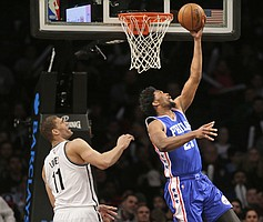 Brooklyn Nets' Brook Lopez, left, watches as Philadelphia 76ers' Joel Embiid shoots during the second half of the NBA basketball game at the Barclays Center, Sunday, Jan. 8, 2017, in New York. (AP Photo/Seth Wenig)