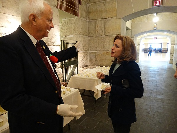 U.S. Rep. Lynn Jenkins visits with Statehouse tour guide Larry Wills and enjoys a piece of Kansas Day birthday cake during a visit to the Statehouse. Jenkins announced earlier this week that she is bowing out of political life and will not run for any office in 2018.