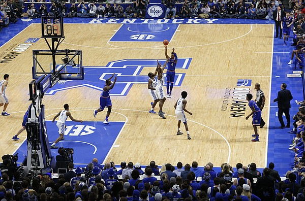 Kansas guard Devonte' Graham (4) puts up a three during the first half against Kentucky, Saturday, Jan. 28, 2017 at Rupp Arena in Lexington, Kentucky.
