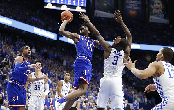 Kansas guard Josh Jackson (11) cuts to the bucket for a shot over Kentucky forward Edrice Adebayo (3) during the second half, Saturday, Jan. 28, 2017 at Rupp Arena in Lexington, Kentucky.