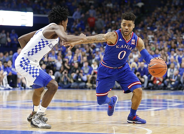Kansas guard Frank Mason III (0) drives against Kentucky guard De'Aaron Fox (0) during the second half, Saturday, Jan. 28, 2017 at Rupp Arena in Lexington, Kentucky.