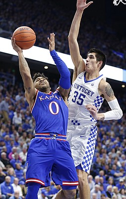 Kansas guard Frank Mason III (0) puts up a shot against Kentucky forward Derek Willis (35) during the second half, Saturday, Jan. 28, 2017 at Rupp Arena in Lexington, Kentucky.