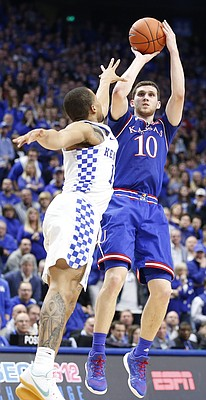 Kansas guard Sviatoslav Mykhailiuk (10) pulls up for a three over Kentucky guard Isaiah Briscoe (13) late in the second half, Saturday, Jan. 28, 2017 at Rupp Arena in Lexington, Kentucky.