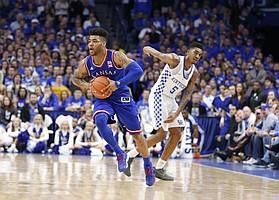 Kansas guard Frank Mason III (0) pushes the ball up the court past Kentucky guard Malik Monk (5) during the second half, Saturday, Jan. 28, 2017 at Rupp Arena in Lexington, Kentucky.
