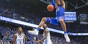 Kansas forward Landen Lucas (33) finishes a dunk before Kentucky guard Malik Monk (5) and Kentucky forward Edrice Adebayo (3) during the second half, Saturday, Jan. 28, 2017 at Rupp Arena in Lexington, Kentucky.