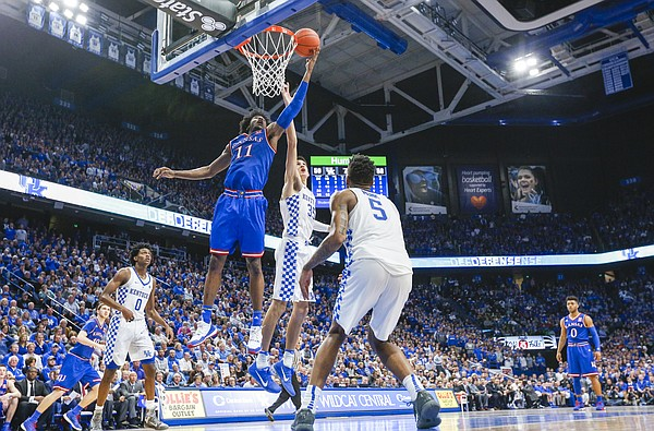 Kansas guard Josh Jackson (11) tips a shot in over Kentucky forward Derek Willis (35) during the second half, Saturday, Jan. 28, 2017 at Rupp Arena in Lexington, Kentucky.