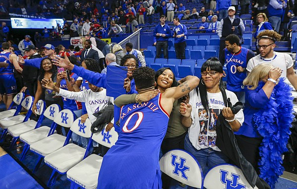 Kansas guard Frank Mason III (0) gives some of his family members a hug following the Jayhawks' 79-73 win over Kentucky, Saturday, Jan. 28, 2017 at Rupp Arena in Lexington, Kentucky.