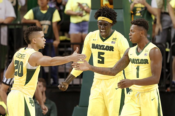 Baylor's Manu Lecomte (20), Wendell Mitchell (1) and Johnathan Motley (5) celebrate in the second half of an NCAA college basketball game against Oregon on Tuesday Nov. 15, 2016, in Waco, Texas.