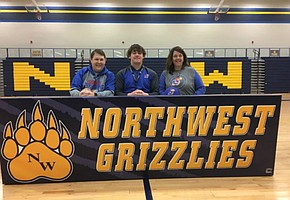 Wichita Northwest offensive lineman Joey Gilbertson poses for photos after signing with Kansas football, on Feb. 1, 2017.