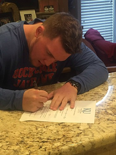 Free State High linebacker Jay Dineen signs his National Letter of Intent with Kansas football, on Feb. 1, 2017.
