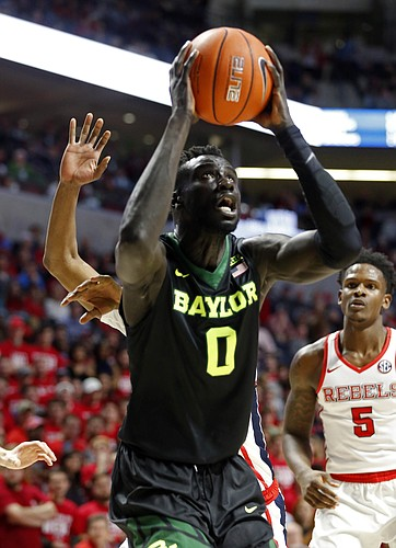 Baylor's Jo Lual-Acuil Jr., (0) takes an uncontested shot at the basket against Mississippi in the first half of an NCAA college basketball game in Oxford, Miss., Saturday, Jan. 28, 2017.