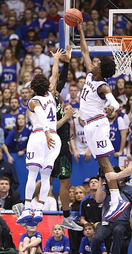 Kansas guard Josh Jackson (11) rejects a shot from Baylor guard Al Freeman (25) during the first half, Wednesday, Feb. 1, 2017 at Allen Fieldhouse.