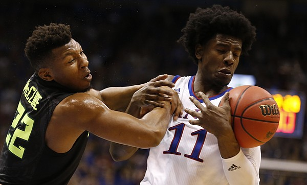 Kansas guard Josh Jackson (11) comes away with a  ball from Baylor guard King McClure (22) during the second half, Wednesday, Feb. 1, 2017 at Allen Fieldhouse.