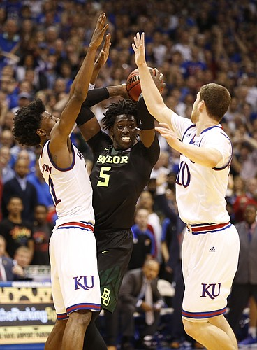 Kansas guard Josh Jackson (11) and Kansas guard Sviatoslav Mykhailiuk (10) trap Baylor forward Johnathan Motley (5) creating a turnover by Motley with seconds remaining in the game, Wednesday, Feb. 1, 2017 at Allen Fieldhouse.