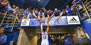 Kansas guard Frank Mason III (0) jumps up to receive KU students gathered over the scoreboard in the northwest tunnel following the Jayhawks' 73-68 win over Baylor,  Wednesday, Feb. 1, 2017 at Allen Fieldhouse.