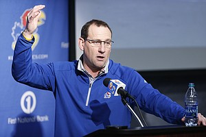 Kansas football head coach David Beaty gives the rundown on his incoming players during a Signing Day news conference at Mrkonic Auditorium in the Anderson Family Football Complex.