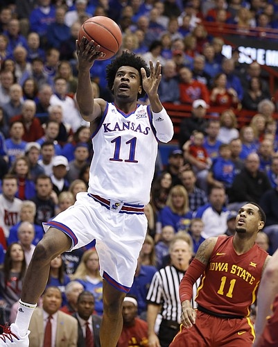 Kansas guard Josh Jackson (11) gets to the bucket past Iowa State guard Monte Morris (11) during the first half, Saturday, Feb. 4, 2017 at Allen Fieldhouse.