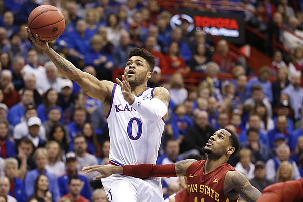 Kansas guard Frank Mason III (0) gets in for a bucket past Iowa State guard Monte Morris (11) during the first half, Saturday, Feb. 4, 2017 at Allen Fieldhouse.
