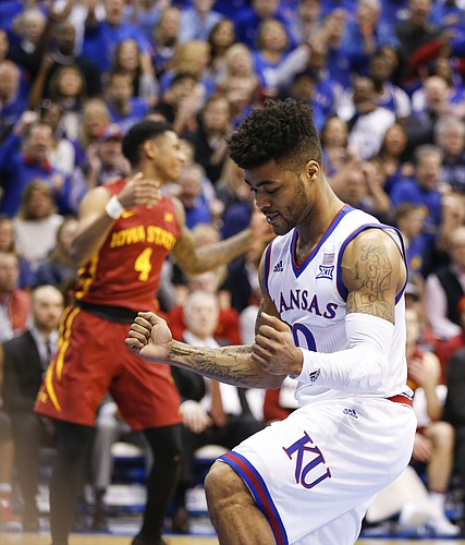 Kansas guard Frank Mason III (0) celebrates a bucket and a foul from Iowa State guard Donovan Jackson (4) during the first half, Saturday, Feb. 4, 2017 at Allen Fieldhouse.