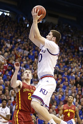 Kansas guard Sviatoslav Mykhailiuk (10) puts up a shot over Iowa State guard Matt Thomas (21) during the first half, Saturday, Feb. 4, 2017 at Allen Fieldhouse.
