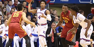 Kansas guard Devonte' Graham (4) heaves a pass up the court after a steal during the first half, Saturday, Feb. 4, 2017 at Allen Fieldhouse.