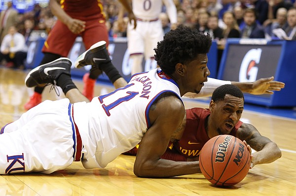 Kansas guard Josh Jackson (11) loses a ball to Iowa State guard Monte Morris during the second half, Saturday, Feb. 4, 2017 at Allen Fieldhouse.