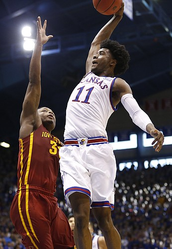 Kansas guard Josh Jackson (11) gets up for an attempted dunk over Iowa State guard Deonte Burton (30) during the second half, Saturday, Feb. 4, 2017 at Allen Fieldhouse. Burton fouled Jackson on the play.