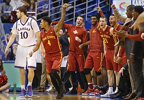 The Iowa State bench reacts after a big bucket by guard Donovan Jackson (4) over Kansas guard Sviatoslav Mykhailiuk (10) late in overtime, Saturday, Feb. 4, 2017 at Allen Fieldhouse.