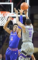 Kansas guard Devonte' Graham (4) defends against a shot from Kansas State guard Barry Brown (5) during the first half, Monday, Feb. 6, 2017 at Bramlage Coliseum.