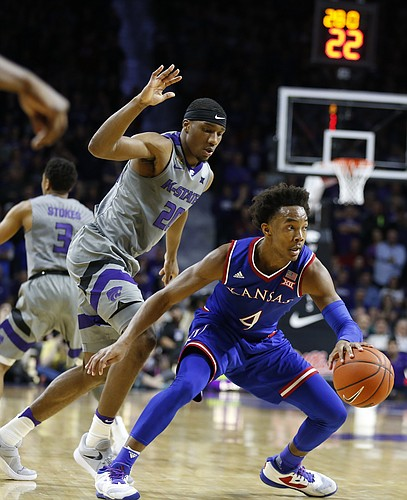 Kansas guard Devonte' Graham (4) looks to shake Kansas State forward Xavier Sneed (20) during the second half, Monday, Feb. 6, 2017 at Bramlage Coliseum.