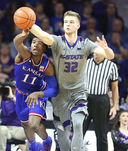 Kansas guard Josh Jackson (11) and Kansas State forward Dean Wade (32) compete for a ball during the second half, Monday, Feb. 6, 2017 at Bramlage Coliseum.