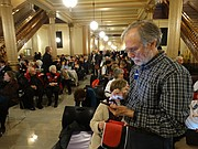 Scores of people forced to sit outside a committee room and listen to a loudspeaker as the House Health and Human Services Committee hears testimony in favor of expanding the state's Medicaid program known as KanCare.