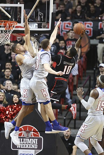 Kansas forward Landen Lucas (33) and Kansas guard Sviatoslav Mykhailiuk (10) get in the face of Texas Tech guard Niem Stevenson (10) during the first half, Saturday, Feb. 11, 2017 at United Supermarkets Arena in Lubbock, Texas.