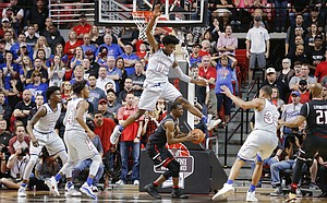 Kansas guard Josh Jackson (11) defends the bucket over Texas Tech guard Keenan Evans (12) late in the second half, Saturday, Feb. 11, 2017 at United Supermarkets Arena in Lubbock, Texas.
