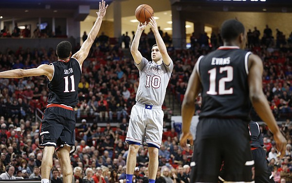 Kansas guard Sviatoslav Mykhailiuk (10) puts up a three over Texas Tech forward Zach Smith (11) during the second half, Saturday, Feb. 11, 2017 at United Supermarkets Arena in Lubbock, Texas.