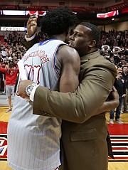 Kansas guard Josh Jackson (11) gets a hug from assistant coach Jerrance Howard as he leaves the floor following the Jayhawks' 80-79 win over Texas Tech, Saturday, Feb. 11, 2017 at United Supermarkets Arena in Lubbock, Texas.
