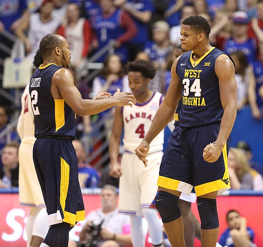 West Virginia guard Jevon Carter (2) celebrates a bucket and a foul with teammate Sagaba Konate during the first half, Monday, Feb. 13, 2017 at Allen Fieldhouse.