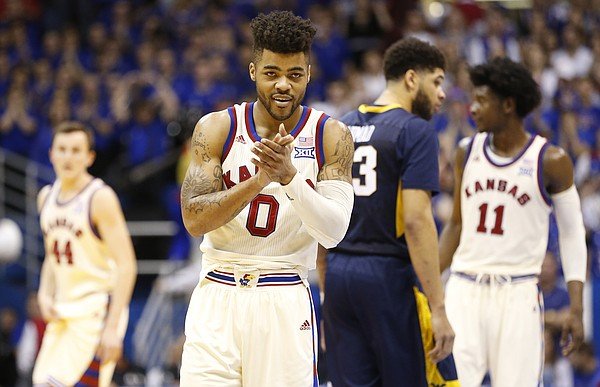 Kansas guard Frank Mason III (0) flashes a smile as the Jayhawks close out the game against West Virginia in overtime, Monday, Feb. 13, 2017 at Allen Fieldhouse.
